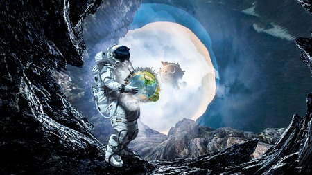 Astronaut carrying Earth planet in hands.