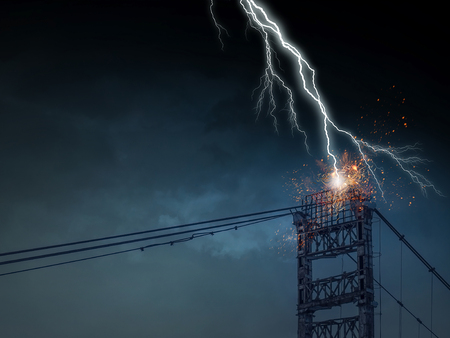 High voltage lines tower and lightning striking it Фото со стока