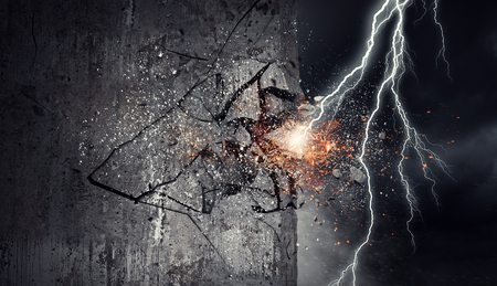 Lightning bolt striking concrete wall. Mixed media Reklamní fotografie