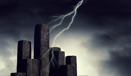 Lightning from sky striking stone graph. background. Mixed media