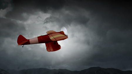 Lightning striking retro plane flying in dark sky. Mixed media