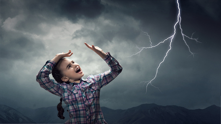 Kid scared with lightning. Mixed media Banque d'images