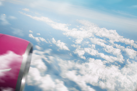 Wing of airplane in sky. Mixed media 版權商用圖片