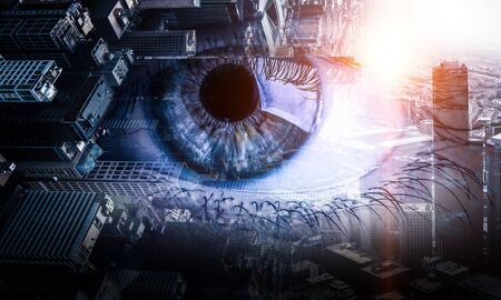 Close up of human eye against modern city background