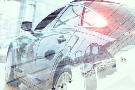 Double exposure of elegant car and modern cityscape 版權商用圖片