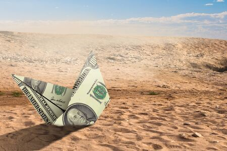 Dollar banknote ship in desert as symbol for financial crisis . Mixed media Banque d'images