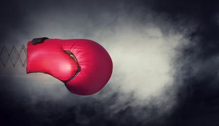 Boxing glove on spring on dark sky background. Mixed media 写真素材 - 97428668