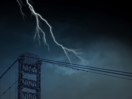 High voltage lines tower and lightning striking it Stock Photo
