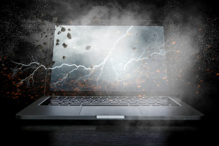 Opened laptop device with lightning on screen. Mixed media
