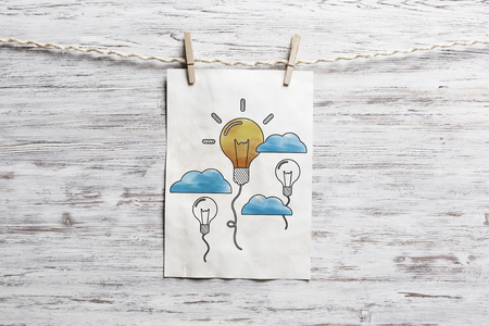 Paper sheet on clip with business sketched ideas. Mixed media Stock Photo