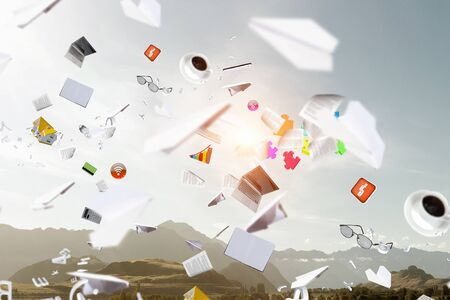 Background image with business items and papers flying in air