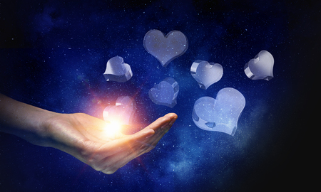 Hand of man and glass heart icon