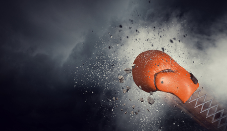 Boxing glove on spring on dark sky background. Mixed media 写真素材 - 98001633