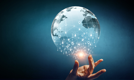 Digital globe as symbol for modern technologies. Mixed media