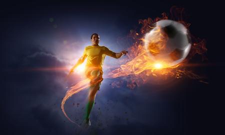 Soccer player kicking ball. Mixed media