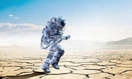 Spaceman in desert. Mixed media