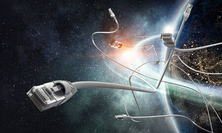 Earth planet and computer connection cord. Elements of this image are furnished by NASA