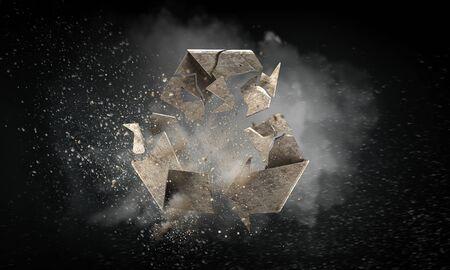 Stone broken recycling symbol on dark background. Mixed media