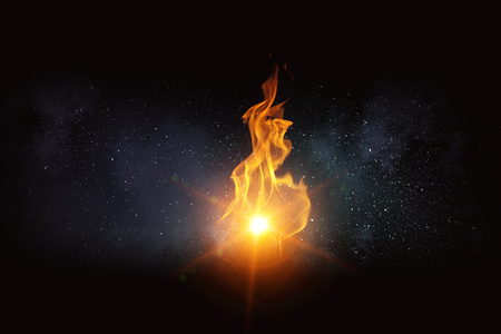 Fire flames burning on dark sky background