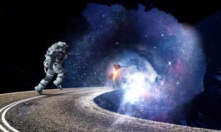 Running spaceman and galaxy. Mixed media Stock Photo