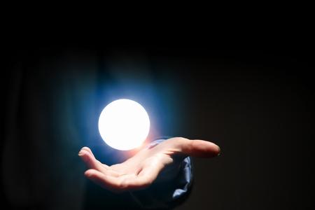 Hand touching the moon Stock fotó