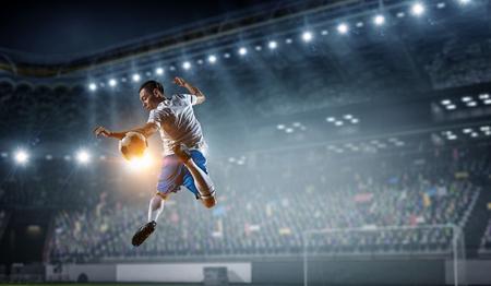 Soccer player at stadium. Mixed media Stock Photo - 100320947