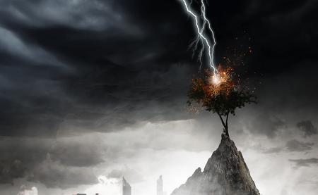Bright lightning hit the tree Stock Photo