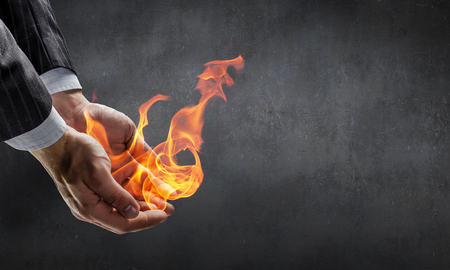 Fire burning in his hands