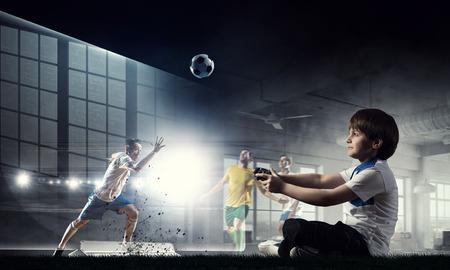 Boy playing a video game. Mixed media Standard-Bild