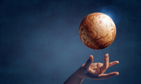 Close of hand taking Venus planet with fingers Stock Photo