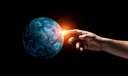 Close of hand touching with finger planet