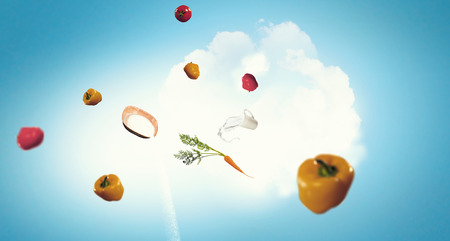 Ingredients for meal flying in air on blue