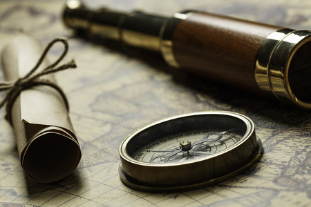 Retro compass with old map and spyglass