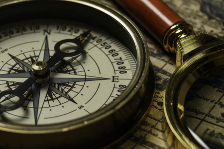 Retro compass with old map and magnifier Stock Photo