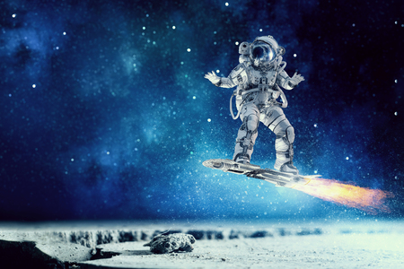 Spaceman on flying board. Mixed media 写真素材