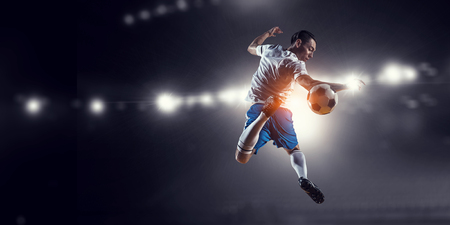 Soccer player at stadium. Mixed media Stock Photo - 100911263
