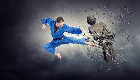 Karate man attack opponent. Mixed media 版權商用圖片
