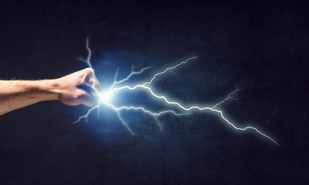Close up of human fist fight lightning