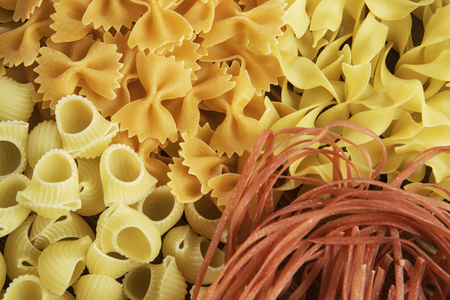 Variety of types and shapes of dry Italian pasta Reklamní fotografie