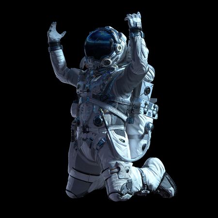Spaceman in white suit on black background. Mixed media Standard-Bild