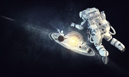 Astronaut floating in outer space. Elements of this image furnished