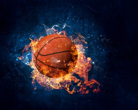 Ball in fire flames on dark background. Mixed media