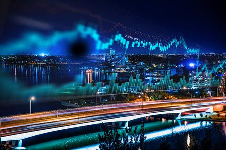 Forex-grafiek en geweldig nachtzicht van de zakenstad