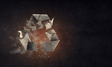 Stone recycling symbol on dark background. Mixed media
