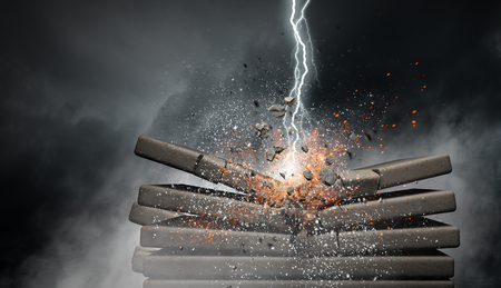 Lightning bolt striking concrete wall. Mixed media Banco de Imagens