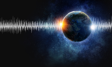 Earth planet and sound wave as concept for seismic activity.