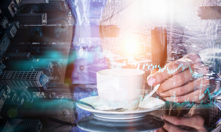 Double exposure of businessman holding cup of coffee and modern cityscape Stock Photo
