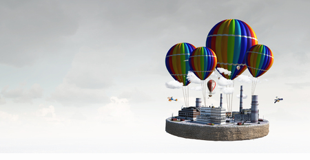 Exterior model flying on color air balloons. Mixed media Stock Photo