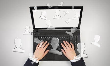 Top view of businesswoman typing on laptop keyboard