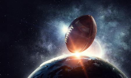 Rugby ball orbiting Earth planet.